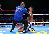Tony Bellew celebrates with his trainer Dave Coldwell after stopping Illunga Makabu in the second round to win the Vacant WBC World Cruiserweight...