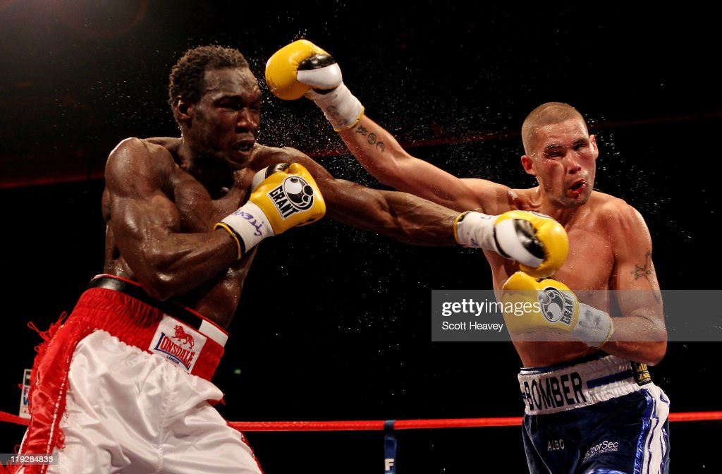 Tony Bellew (R) connects with Ovill McKenzie during the Commonwealth And Vacant British Light-Heavyweight Championship bout at Echo Arena on July 16, 2011 in Liverpool, England.