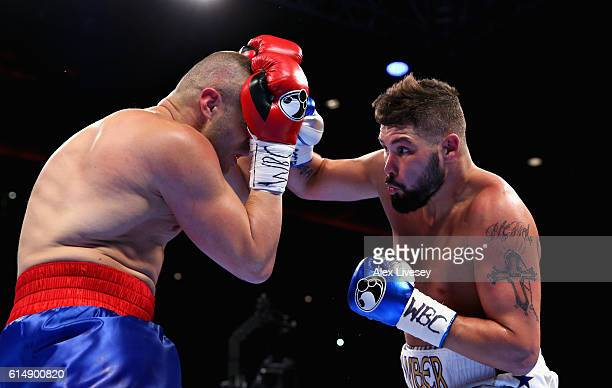 Tony Bellew of England lands a right hand punch on BJ Flores of USA in the WBC Cruiserweight Championship match during Boxing at Echo Arena on...