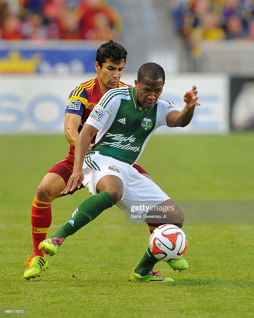 Tony Beltran of Real Salt Lake and Darlington Nagbe of the Portland Timbers vie for the ball during their game at Rio Tinto Stadium April 19 2014 in...