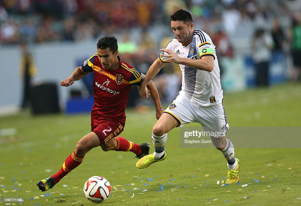 Tony Beltran #2 of Real Salt Lake and Robbie Keane #7 of the Los Angeles Galaxy fight for the ball in Leg 2 of the Western Conference Semifinals at StubHub Center on November 9, 2014 in Los Angeles, California.