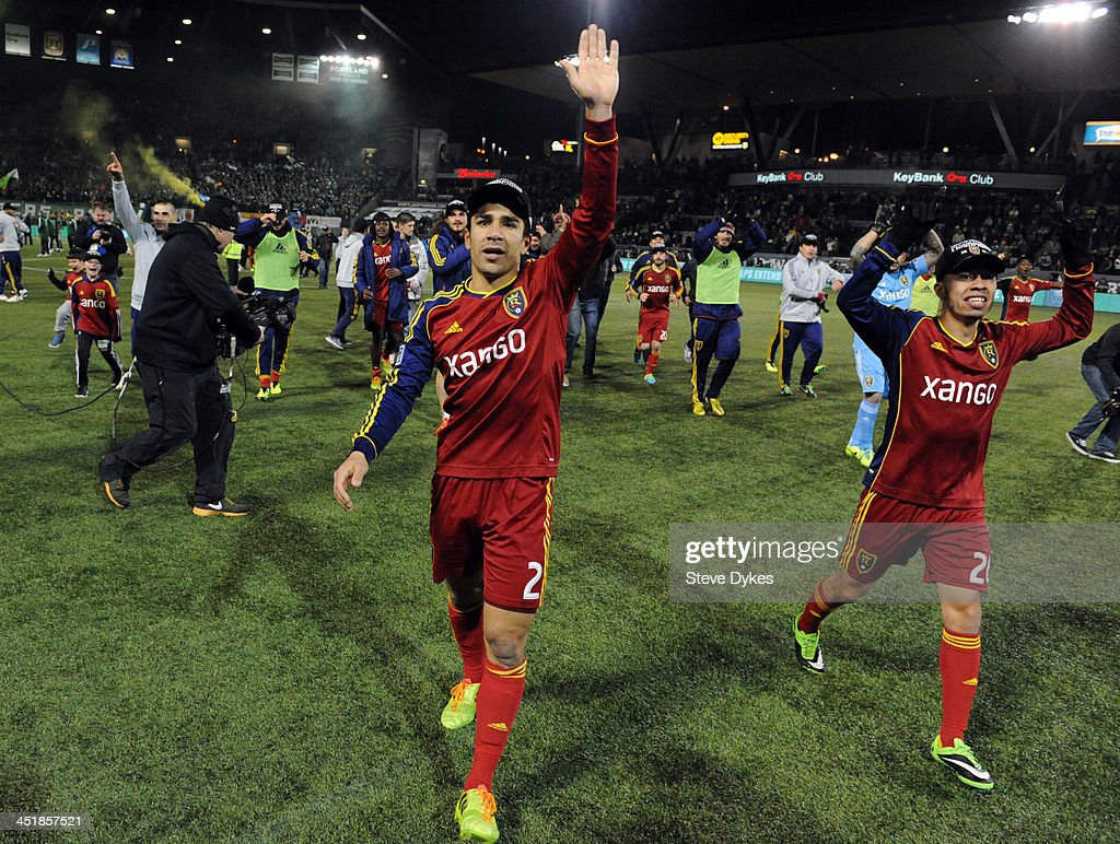 Tony Beltran of Real Salt Lake and Sebastian Velasquez of Real Salt Lake celebrate after the game against the Portland Timbers at JeldWen Field on...
