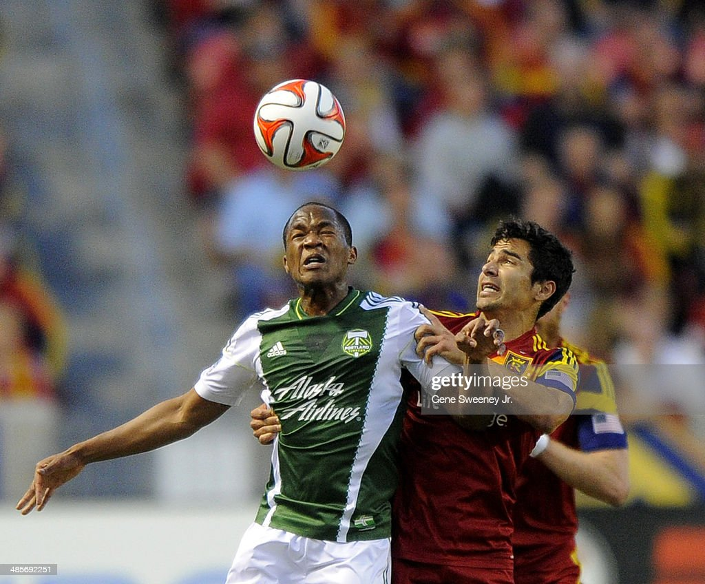 Tony Beltran of Real Salt Lake grabs Darlington Nagbe of the Portland Timbers as they go for a header during their game at Rio Tinto Stadium April 19...