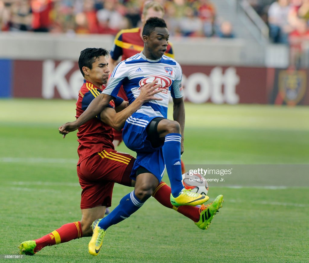 Tony Beltran of Real Salt Lake grabs Fabian Castillo of FC Dallas as the try for the ball during first half play at Rio Tinto Stadium May 24 2014 in...
