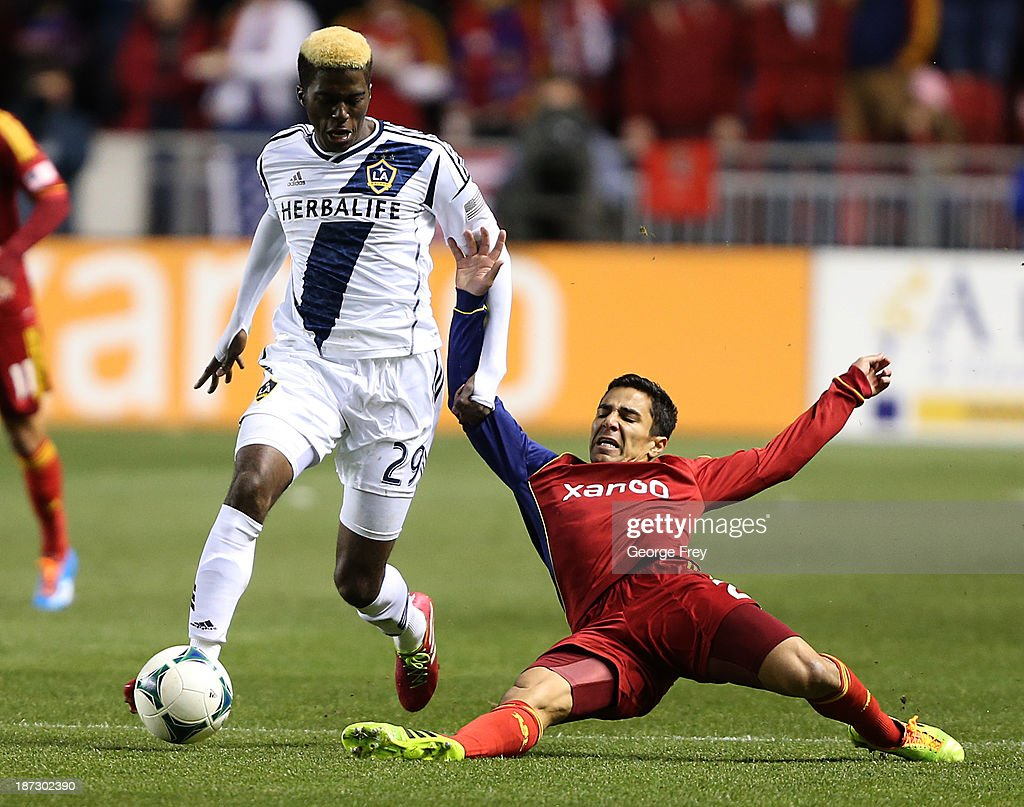Tony Beltran of Real Salt Lake has the ball taken from him by Gyasi Zardes of the Los Angeles Galaxy during the first half of an Western Conference...