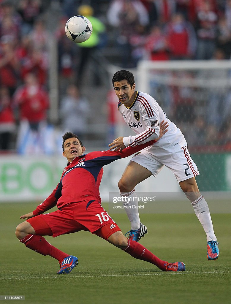 Tony Beltran of Real Salt Lake heads the ball over Marco Pappa of the Chicago Fire during an MLS match at Toyota Park on May 9 2012 in Bridgeview...