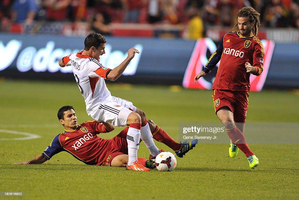 Tony Beltran of Real Salt Lake tackles Chris Pontius of DC United as Kyle Beckerman of Real Salt Lake runs in at Rio Tinto Stadium October 1 2013 in...