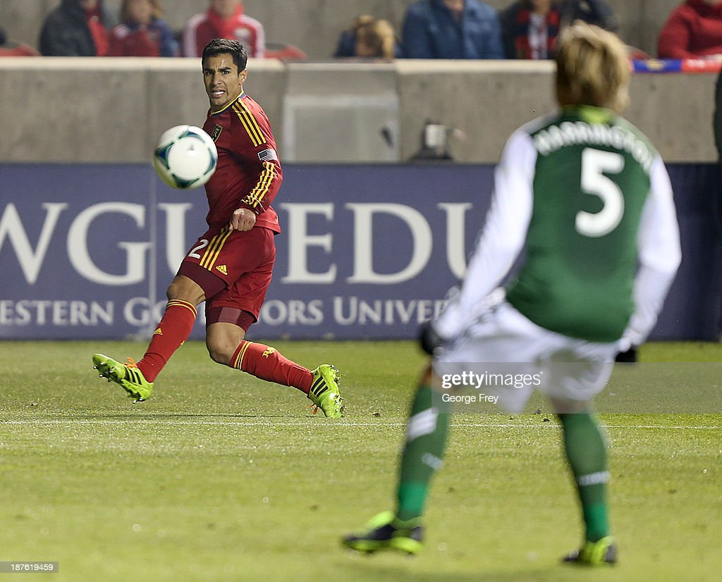 Tony Beltran of Real Salt Lake takes a shot on goal as Eric Brunner of the Portland Timbers defends during the first half of the Western Conference...