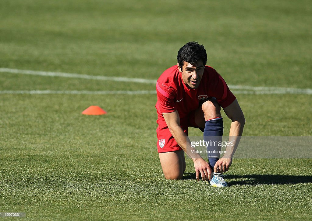 Tony Beltran ties his shoelace during the U.S. Men's Soccer Team training session at the Home Depot Center on January 17, 2013 in Carson, California.