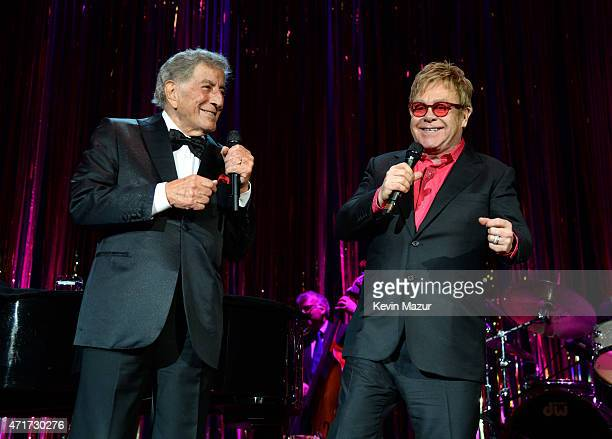 Tony Bennett and Elton John perform onstage during Breast Cancer Research Foundation's Hot Pink Party The Pink Standard at Waldorf Astoria Hotel on...
