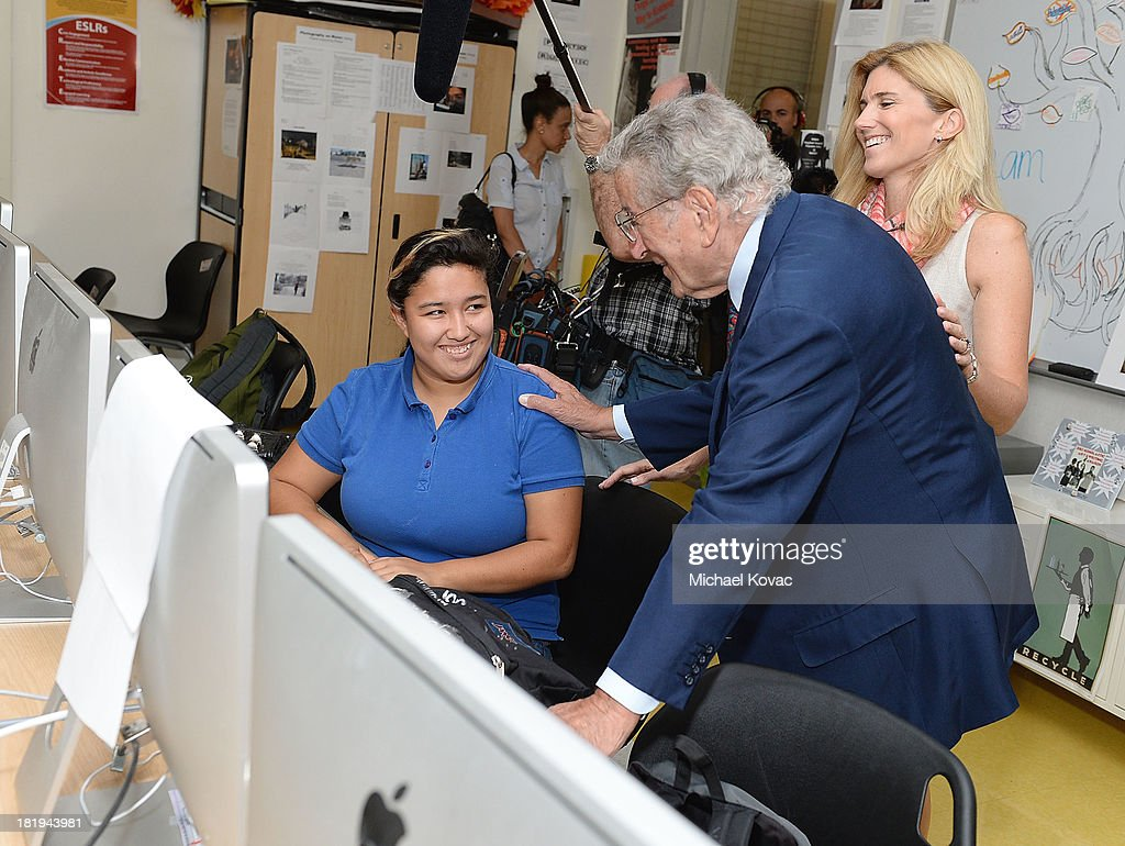 Tony Bennett (C) and his wife, Susan Benedetto (R) speak with a student during a tour of the campus of Esteban E. Torres High School in support of the L.A. expansion of NYC based non-profit organization, Exploring the Arts, on September 26, 2013 in Los Angeles, California.