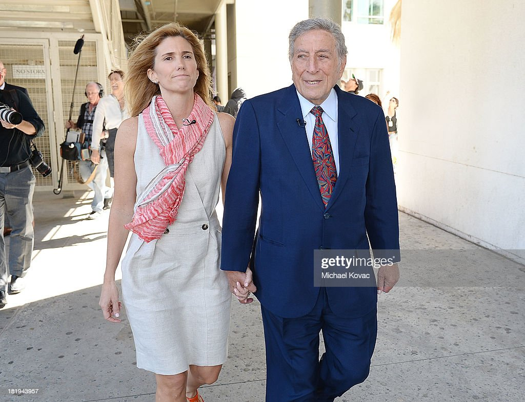 <a gi-track='captionPersonalityLinkClicked' href=/galleries/search?phrase=Tony+Bennett+-+Singer&family=editorial&specificpeople=160951 ng-click='$event.stopPropagation()'>Tony Bennett</a> (R) and his wife, Susan Benedetto tour the campus of Esteban E. Torres High School in support of the L.A. expansion of NYC based non-profit organization, Exploring the Arts, on September 26, 2013 in Los Angeles, California.