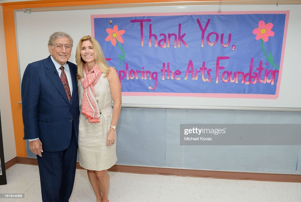 <a gi-track='captionPersonalityLinkClicked' href=/galleries/search?phrase=Tony+Bennett+-+Singer&family=editorial&specificpeople=160951 ng-click='$event.stopPropagation()'>Tony Bennett</a> (L) and his wife, Susan Benedetto tour the campus of Esteban E. Torres High School in support of the L.A. expansion of NYC based non-profit organization, Exploring the Arts, on September 26, 2013 in Los Angeles, California.