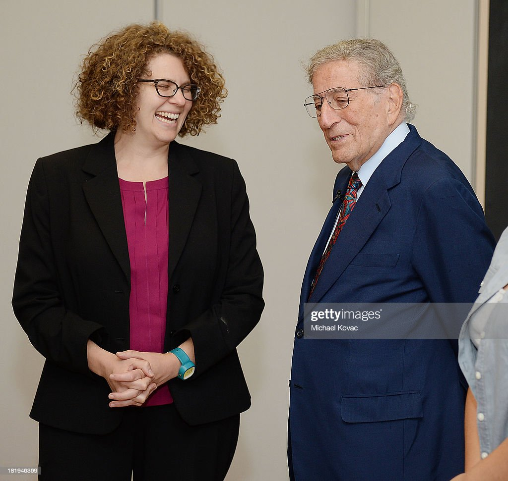<a gi-track='captionPersonalityLinkClicked' href=/galleries/search?phrase=Tony+Bennett+-+Singer&family=editorial&specificpeople=160951 ng-click='$event.stopPropagation()'>Tony Bennett</a> (R) meets with Humanitas Academy of Art and Technology principal Deborah A. Lowe while touring the campus of Esteban E. Torres High School in support of the L.A. expansion of NYC based non-profit organization, Exploring the Arts, on September 26, 2013 in Los Angeles, California.