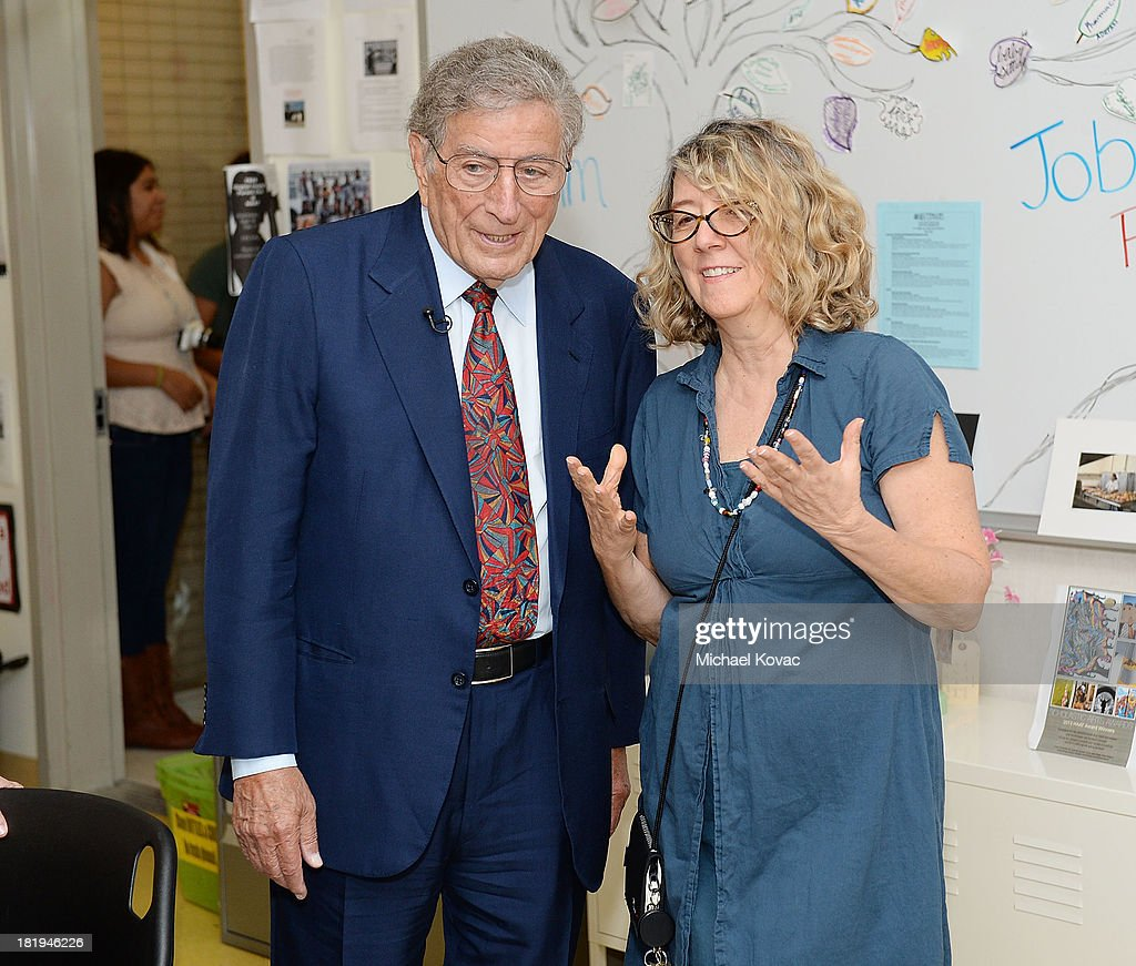 <a gi-track='captionPersonalityLinkClicked' href=/galleries/search?phrase=Tony+Bennett+-+Singer&family=editorial&specificpeople=160951 ng-click='$event.stopPropagation()'>Tony Bennett</a> (L) meets with teacher Joan Dooley while touring the campus of Esteban E. Torres High School in support of the L.A. expansion of NYC based non-profit organization, Exploring the Arts, on September 26, 2013 in Los Angeles, California.