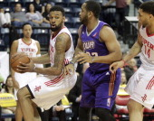 Tony Bishop Jr #23 of the Rio Grande Valley Vipers dribbles the ball past Austin Freeman of the Iowa Energy on March 26 2014 at the State Farm Arena...
