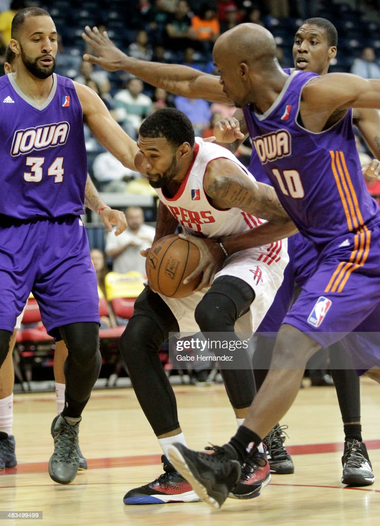 Tony Bishop Jr. #23 of the Rio Grande Valley Vipers rebounds the ball against Jackie Carmichael #34, left, <a gi-track='captionPersonalityLinkClicked' href=/galleries/search?phrase=Curtis+Stinson&family=editorial&specificpeople=234919 ng-click='$event.stopPropagation()'>Curtis Stinson</a> #10 of the Iowa Energy on April 8, 2014 during game one first round of the 2014 NBA-Development League playoffs at the State Farm Arena in Hidalgo, Texas.