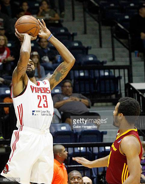 Tony Bishop of the Rio Grande Valley Vipers shoots over Chris Crawford of the Canton Charge on December 20 2014 at the State Farm Arena in Hidalgo...