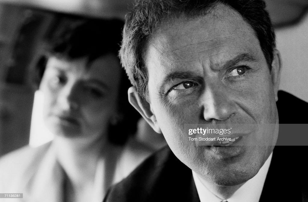 Tony Blair MP looking serious during his successful 1997 General Election campaign to become Britain's first Labour Prime Minister since 1979. HIs wife Cherie is in the background.