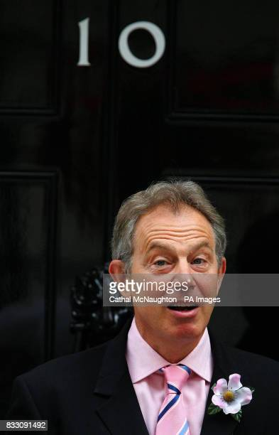Tony Blair pictured with his Alexandra Rose which he received from collector Emily Seward outside Number 10 Downing Street central London Alexandra...