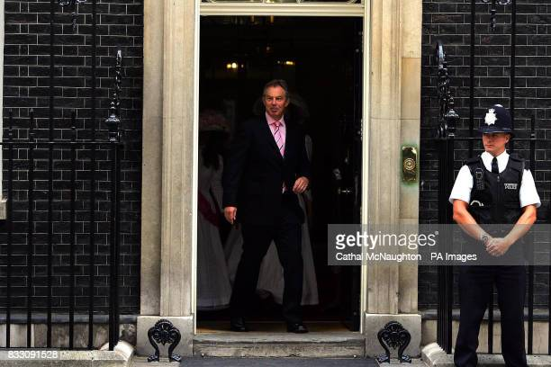 Tony Blair prepares to receive a rose from Alexandra Rose Day collector Emily Seward outside Number 10 Downing Street central London Alexandra Rose...