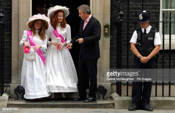 Tony Blair receives a kiss from Alexandra Rose Day collector Emily Seward as Mackie Siebens focuses on the press outside Number 10 Downing Street...
