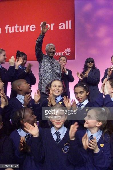Tony Blair singer Gabrielle and a group of schoolchildren surround Nelson Mandela as he addresses the Labour Party Conference on its final day...