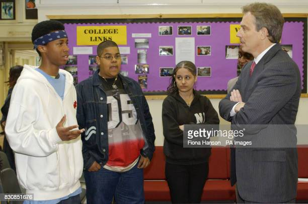 Tony Blair talks to students from left Dwayne Byam Reuben Smart 14 and Regina Wroblewska at the Pupil Referral Unit in Hammersmith west London The...