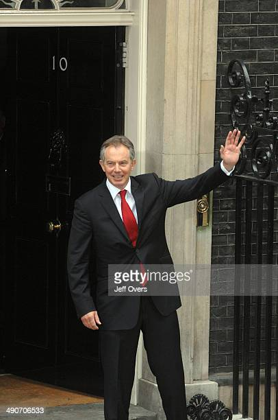 Tony Blair waves to the press from the doorstep of 10 Downing Street on return from his final Prime Minister's Questions on the day that he steps...
