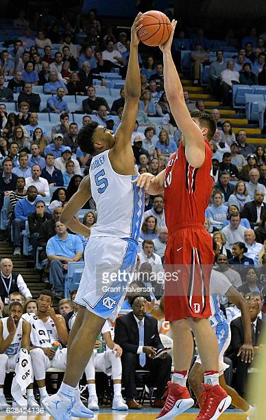 Tony Bradley of the North Carolina Tar Heels blocks a shot by Andrew McAuliffe of the Davidson Wildcats during the game at the Dean Smith Center on...