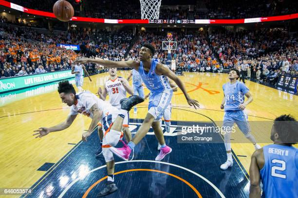 Tony Bradley of the North Carolina Tar Heels blocks a shot by London Perrantes of the Virginia Cavaliers during a game at John Paul Jones Arena on...