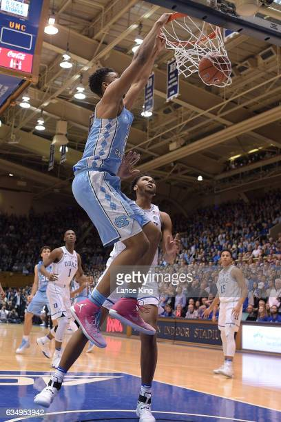 Tony Bradley of the North Carolina Tar Heels dunks the ball against Marques Bolden of the Duke Blue Devils at Cameron Indoor Stadium on February 9...