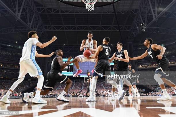Tony Bradley of the North Carolina Tar Heels gets a rebound against Jordan Mathews and Nigel WilliamsGoss of the Gonzaga Bulldogs during the 2017...