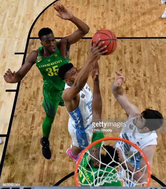 Tony Bradley of the North Carolina Tar Heels gets a rebound over Dylan Ennis of the Oregon Ducks during the 2017 NCAA Men's Final Four Semifinal at...