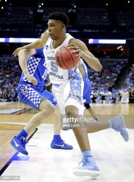 Tony Bradley of the North Carolina Tar Heels handles the ball against Isaac Humphries of the Kentucky Wildcats in the first half during the 2017 NCAA...