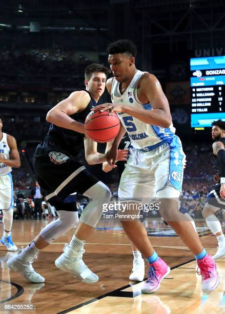Tony Bradley of the North Carolina Tar Heels handles the ball against Zach Collins of the Gonzaga Bulldogs in the second half during the 2017 NCAA...