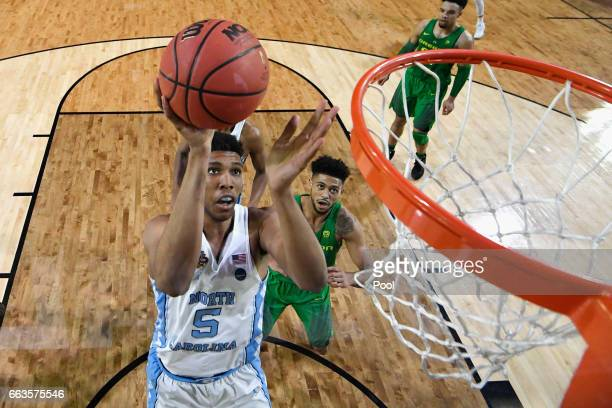 Tony Bradley of the North Carolina Tar Heels shoots against Tyler Dorsey of the Oregon Ducks during the 2017 NCAA Men's Final Four Semifinal at...