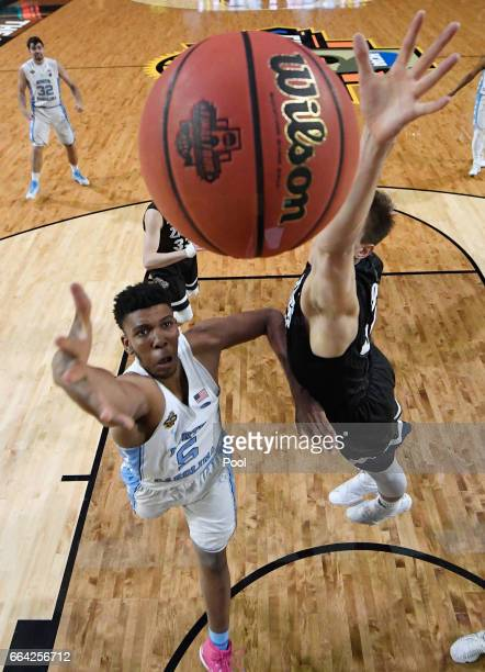 Tony Bradley of the North Carolina Tar Heels shoots against Zach Collins of the Gonzaga Bulldogs in the first half during the 2017 NCAA Men's Final...