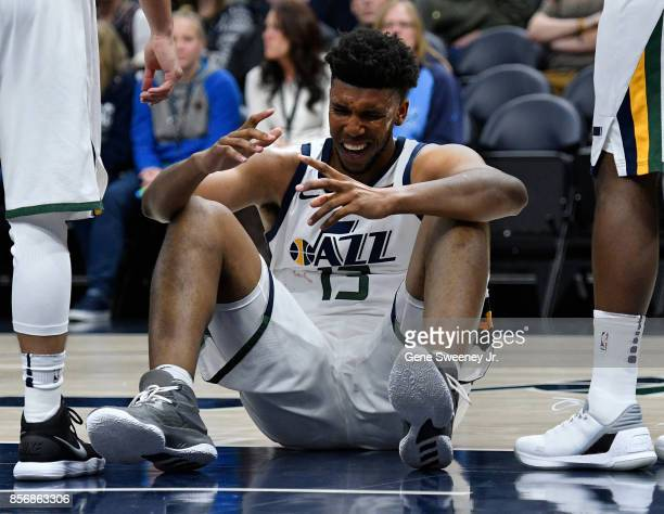 Tony Bradley of the Utah Jazz grimaces after being hit in the eye during the second half their 10883 win over the Sydney Kings in their preseason...