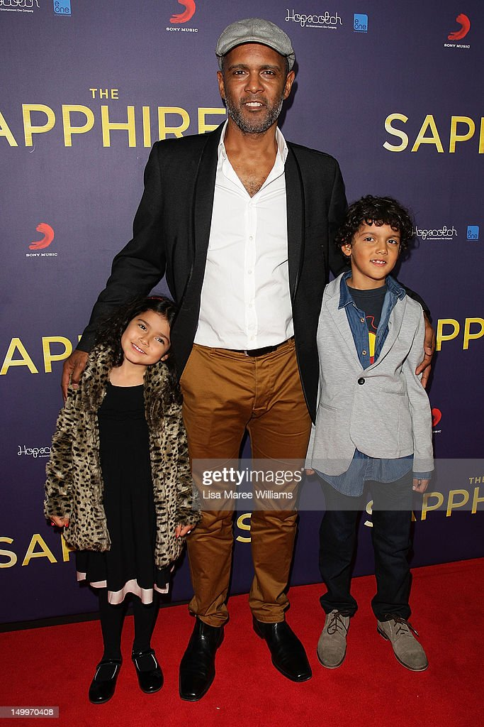 Tony Briggs and his children Soraya Briggs and Carlin Briggs pose on the red carpet at the Sydney Premiere of The Sapphires at State Theatre on August 8, 2012 in Sydney, Australia.