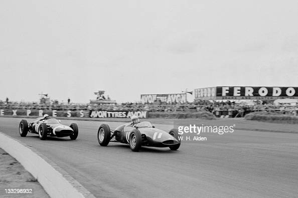 Tony Brooks of Great Britain drives the Owen Racing Organisation BRM P48 ahead of Stirling Moss driving the Rob Walker Racing Cooper T53 Climax...