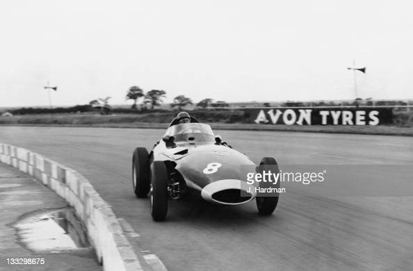 Tony Brooks of Great Britain drives the Vanwall VW5 round Copse Corner during practice for the XIII RAC British Grand Prix on 18th July 1958 at the...