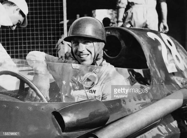 Tony Brooks of Great Britain sits aboard the Vanwall VW5 during the Italian Grand Prix on 7th September 1958 at the Autodromo Nazionale Monza near...