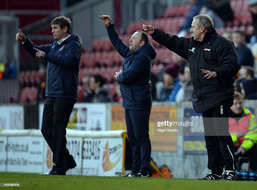 Tony Burnham (R) manager of Dartford and Phil Parkinson (L) manager of Bradford City during the FA Cup Second Round football match between Bradford City and Dartford at Coral Windows Stadium, Valley Parade on December 7, 2014 in Bradford, England.