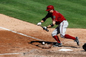 Tony Campana of the Arizona Diamondbacks bunts during the game against the Philadelphia Phillies at Citizens Bank Park on August 25 2013 in...