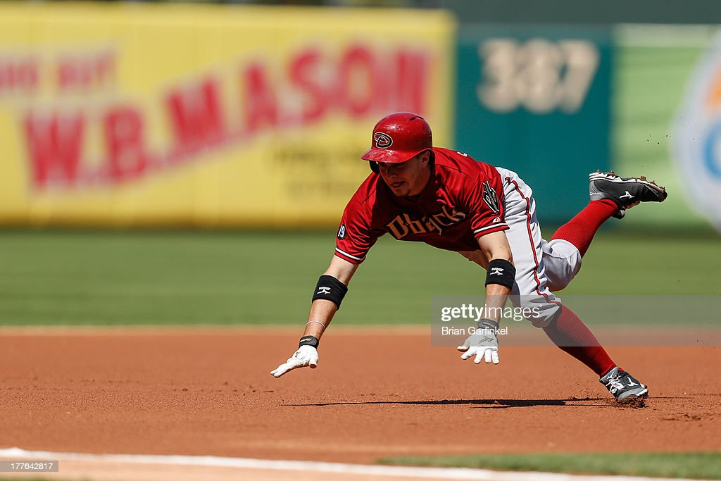 <a gi-track='captionPersonalityLinkClicked' href=/galleries/search?phrase=Tony+Campana&family=editorial&specificpeople=7800014 ng-click='$event.stopPropagation()'>Tony Campana</a> #19 of the Arizona Diamondbacks slides into third after hitting a triple in the first inning of the game against the Philadelphia Phillies at Citizens Bank Park on August 25, 2013 in Philadelphia, Pennsylvania.