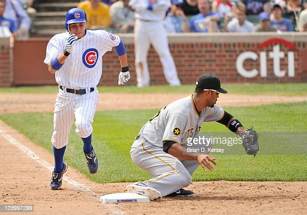 Tony Campana of the Chicago Cubs runs towards first base as first baseman Derrek Lee of the Pittsburgh Pirates catches retires him at Wrigley Field...
