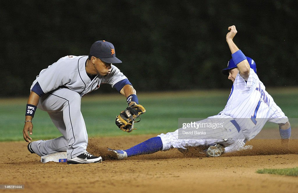 Tony Campana #1 of the Chicago Cubs steals second base as Ramon Santiago #39 of the Detroit Tigers makes a late tag in the seventh inning on June 12, 2012 at Wrigley Field in Chicago, Illinois.