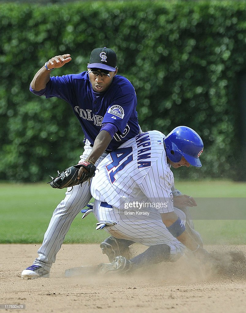 Tony Campana of the Chicago Cubs steals second base as second baseman Jonathan Herrera of the Colorado Rockies tries to make a tag during the sixth...