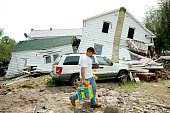 Tony Carr carries his childrens' toys from his home which was destroyed by the floods caused by Hurricane Irene on September 1 2011 in Prattsville NY...